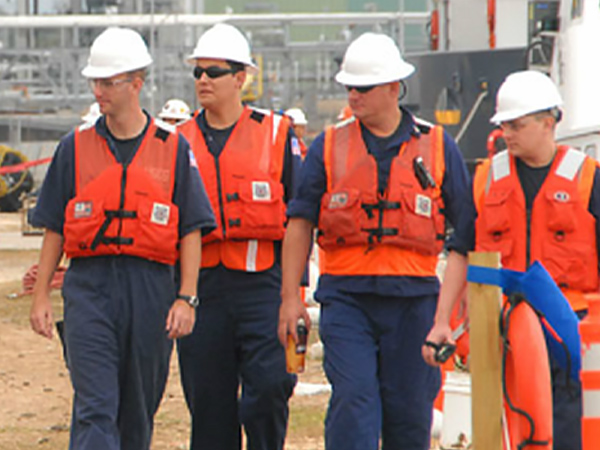 Four members of Patriot Environmental Services' National Response team overseeing a waste project