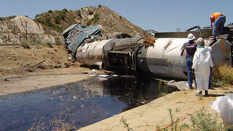 A Patriot Environmental Services team assesses the cleanup of spilled material from an overturned tanker truck