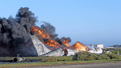Patriot Environmental Services response team prepares to assist with the cleanup after an airplane burns after crashing