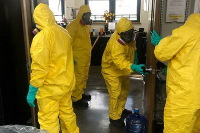 A Patriot Environmental Services emergency response team performing a COVID-19 decontamination to an office building