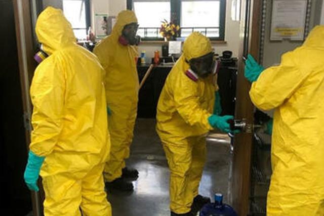 A Patriot Environmental Services team decontaminates a healthcare facility