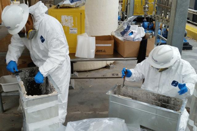 Patriot Environmental Services waste technicians prepare hazardous waste for shipping